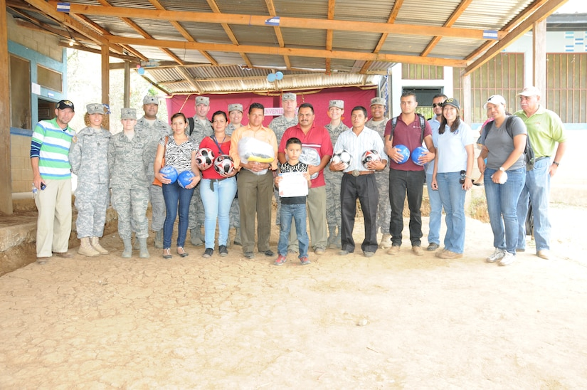 Joint Task Force-Bravo service members present soccer balls and shirts that were donated by the Kick for Nick Foundation to the community during a Medical Readiness Training Exercise in El Naranjo, a remote village in the La Paz region of Honduras, April 24-25.  The Medical Element, with support from JTF-Bravo Joint Security Forces, partnered with the Honduran Ministry of Health, the Honduran National Police, and the Honduran military to provide medical care to nearly 1,000 people over a two day period.  The teams worked together to provide preventive medicine to their patients which included classes on hygiene, hand washing, preventive dental care, and nutrition.  They also provided immunizations to infants, dental care, well women screenings, wellness checkups, medications, and minor medical procedures.  (Photo by U. S. Air National Guard Capt. Steven Stubbs)