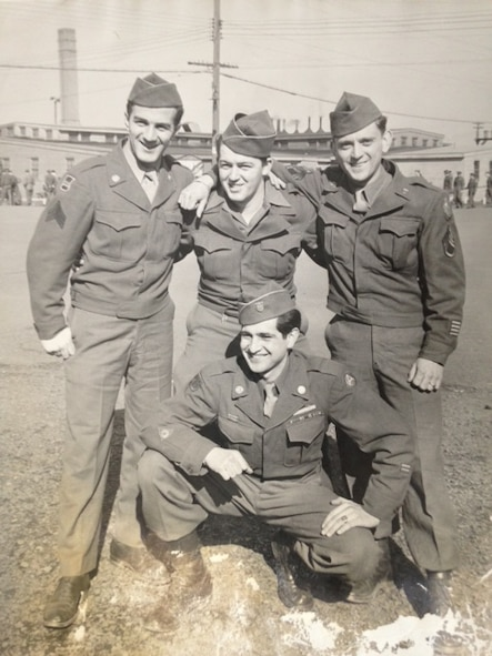 Sgt. Tom Boliaris, standing at left with unidentified fellow soldiers in 1946, served in the 371FG late in WWII, including when the group was based in Germany. (Courtesy Ms. Nancy Beaumier, daughter of 371FG veteran Cpl. Tom Boliaris)