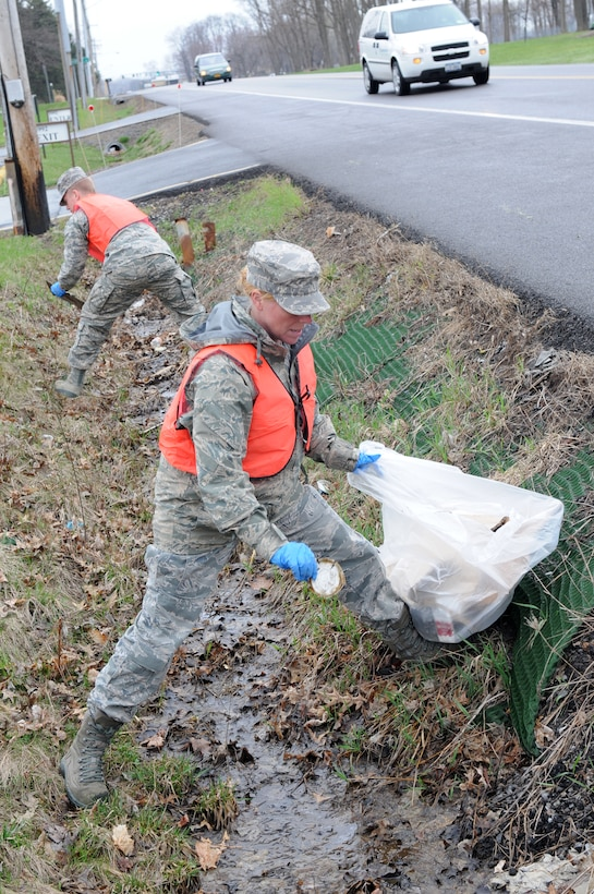 Master Sgt. Sherry Correll removes trash from the side of E. Molloy Road during Earth Day 22 April 2014. Earth Day is held annually on the 22nd of April, was first celebrated in 1970 and is now held in over 192 countries. (New York Air National Guard Photo By Senior Airman Duane Morgan)