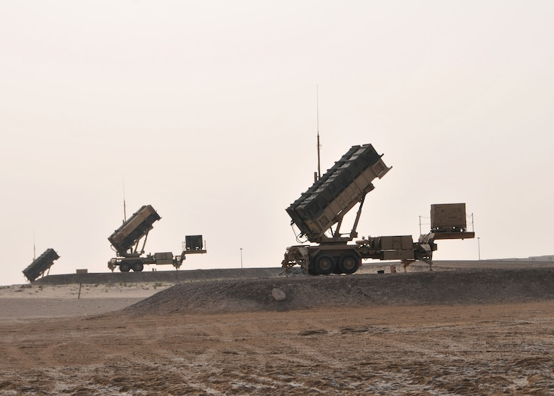 A set of three Army Patriot missile launchers assigned to Charlie Battery, 3rd Battalion, 4th Air Defense Artillery Regiment stand ready to defend the 380th Air Expeditionary Wing against airborne threats to at an undisclosed location in Southwest Asia on April 24, 2014. (U.S. Air Force photo by Senior Master Sgt. Eric Peterson/Released)