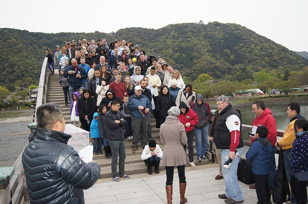 Lt. Cmdr. Louis Lee, command chaplain with the Marine Memorial Chapel, speaks to members attending the Easter Sunrise Service at the Kintai Bridge in Iwakuni, Japan, April 20, 2014. The purpose of the service was to reflect on the principles of Easter and to bring the community closer together.