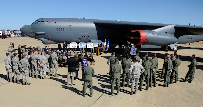 Barksdale Air Force Base members attend a ceremony in recognition of a B-52H Stratofortress returning from Tinker Air Force Base, Okla., April 25, 2014, on the flightline at Barksdale Air Force Base, La. The B-52 is the first of its kind to receive a new Combat Network Communications Technology system, complete with state of the art displays, servers and communications uplinks. (U.S. Air Force photo/Senior Airman Joseph A. Pagán Jr.)