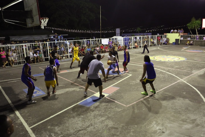 Photo by Lance Cpl. Trever Statz   The Tamaoyan and U.S. service member teams play together at the Barangay Tamaoyan Friendship basketball game April 24 during exercise Balikatan 2014 in Legazpi City, Albay Province, Philippines. Basketball, one of the most popular sports in the Philippines, provided the local community and U.S. service members with the opportunity to interact and get to know one another on a personal level. Balikatan is an annual bilateral exercise between the Armed Forces of the Philippines and U.S. armed forces designed to strengthen interoperability and country-to-country relations.