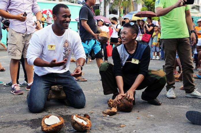 "U.S. Navy Petty Officer 2nd Class Carl Watson, left, breaks open a coconut April 24 during the Kudkod-Paga, Turo-Gata contest at the Magayan Festival alongside Philippine Army Pfc. Bryldon Alforte in Legazpi City, Albay Province, Philippines. Kudkod-Paga, Turo-Gata means ""coconut milk extraction contest,"" and is a contest during the annual festival to determine who can produce the most milk in a given time. Watson and Alforte are part of Exercise Baltikatan, an annual bilateral exercise between the Armed Forces of the Philippines and United States armed forces that strengthens the bond and improves interoperability between the two countries. Alforte is an operations noncommissioned officer, and Watson is a naval builder."