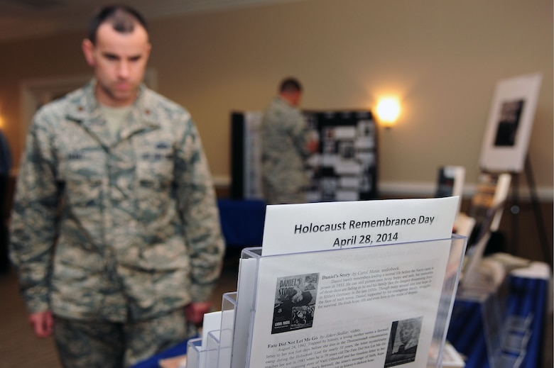 Airmen tour a Holocaust Remembrance Day Museum, April 28, 2014, at Seymour Johnson Air Force Base, N.C. The museum featured photos, books and Jewish articles relating to the Holocaust experience and Jewish customs. (U.S. Air Force photo/Senior Airman John Nieves Camacho)