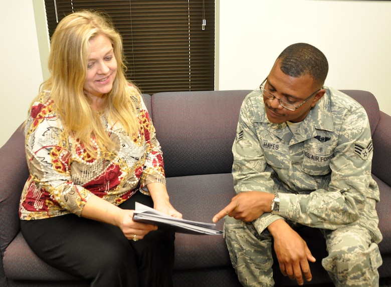 Julie Russell, psychological health director, chats with SrA Colin Hayes, medical technition at the 459th Aeromedical Evacuation Squadron, on the importance of psychological health, April 28, 2014. The Psychological Health Program is a new program at the wing and is geared toward helping Airmen and their families maximize psychological health, resilience, and wellbeing so they can overcome the challenges of life both in and out of the military. (U.S. Air Force photo/ Staff Sgt. Katie Spencer)