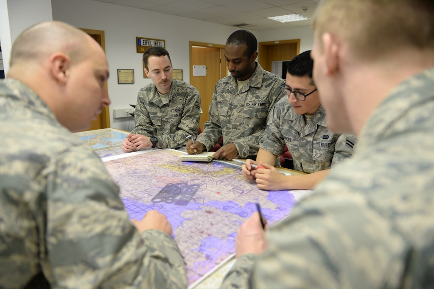 U.S. Air Force Airmen from the 52nd Intelligence Flight, review a map of Germany during training at Spangdahlem Air Base, Germany. Members have to get specialized training on the F-16 Fighting Falcon before being mission capable for the 480th Fighter Squadron. Slots were cut last year and without training, the Airmen couldn't deploy or support the mission. To avoid mission failure, the intelligence flight here was the first and only to teach the F-16 Intelligence Formal Training Unit at home base. (U.S. Air Force photo by Senior Airman Siekert/Released)