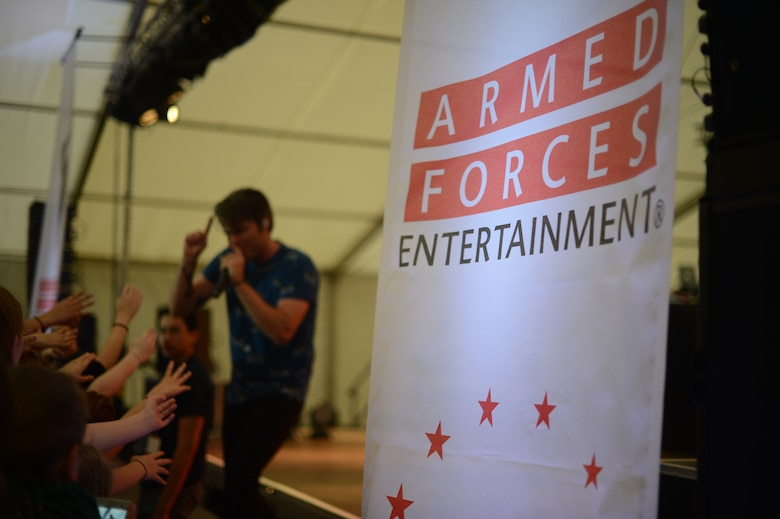 Sean Foreman, American musician, performs on stage during a free concert hosted by Armed Forces Entertainment April 25th, 2014, at Ramstein Air Base Germany. Foreman is a part of 3OH!3, an American electronic musical duo from Boulder, Colorado. The duo spent time at the USO Warrior Center interacting with Wounded Warriors before they performed for Airmen and their families. (U.S. Air Force Photo/Airman 1st Class Michael Stuart)