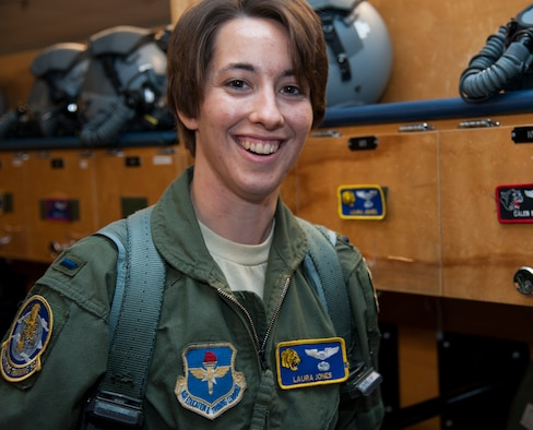 First Lt. Laura Jones poses for a photo after preparing for a flight April 21, 2014, at Laughlin Air Force Base, Texas. Jones was involved in an automobile accident Jan. 2, 2014, that kept her from flying for three months. Jones is a 85th Flying Training Squadron T-6A Texan II instructor pilot. (U.S. Air Force photo/Airman 1st Class Jimmie D. Pike)