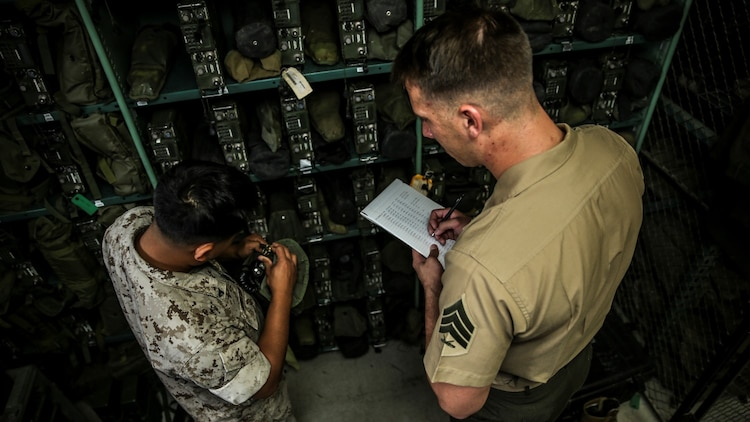 Sergeant Kristopher Golden, right, radio chief, conducts an inventory with Cpl. Amos Nunglian, field radio operator, both with the 15th Marine Expeditionary Unit aboard Camp Pendleton, Calif., April 25, 2014. Golden, 27, is from Lacey, Wash.
