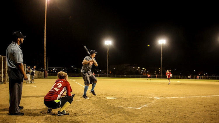 Sergeant Kristopher Golden, radio chief, 15th Marine Expeditionary Unit, waits for his pitch during a softball game aboard Camp Pendleton, Calif., April 23, 2014. Golden, 27, is from Lacey, Wash.