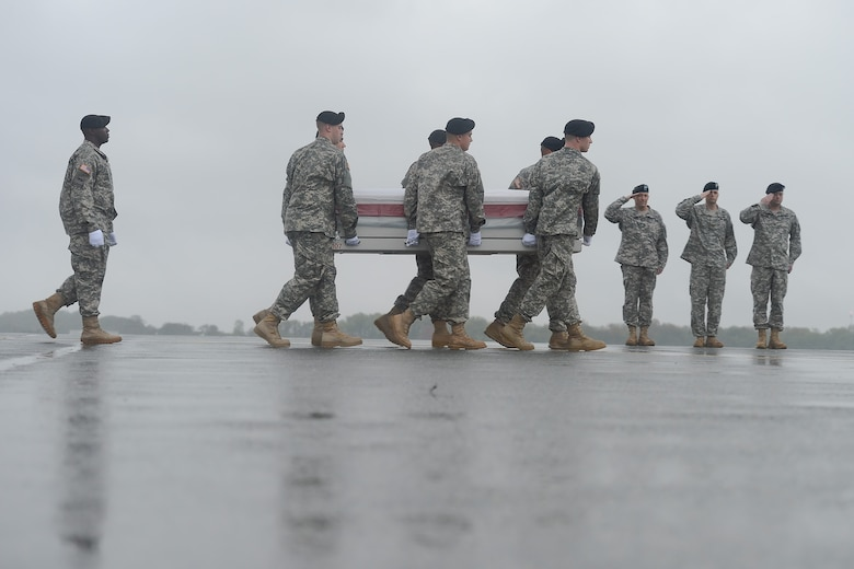 A U.S. Army carry team transfers the remains of Pfc. Christian J. Chandler, of Trenton, Texas, during a dignified transfer April 30, 2014 at Dover Air Force Base, Del. Chandler was assigned to Company B, 2nd Battalion, 87th Infantry Regiment, 3rd Brigade Combat Team, 10th Mountain Division (Light), Fort Drum, N.Y. (U.S. Air Force photo/Greg L. Davis)