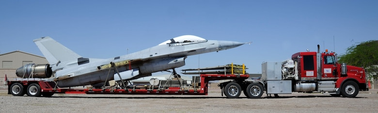 A disassembled F-16 Fighting Falcon sits on the bed of an 18-wheeler at Davis-Monthan Air Force Base, Ariz., April 30, 2014. The aircraft was received from the 309th Aircraft Maintenance and Regeneration Group and disassembled by members of the 149th Fighter Wing during their recent temporary duty assignment to D-M. (U.S. Air Force photo by Airman 1st Class Betty R. Chevalier/Released)