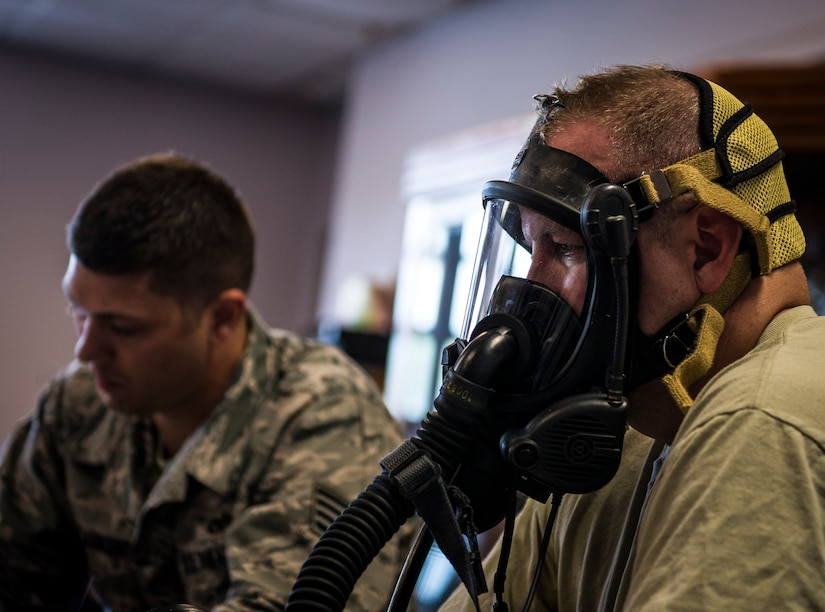 Col. Jeffrey DeVore, Joint Base Charleston commander, undergoes a mask-fit test conducted by Staff Sgt. Anthony Ankeny, 628th Civil Engineer Squadron Fire Department lead fire fighter, during a 628th AB Wing leadership visit April 27, 2014, at the JB Charleston Fire Department. DeVore, Capt. Timothy Sparks, JB Charleston deputy commander, Master Chief Petty Officer Joseph Gardner, Naval Support Activity command master chief, and Chief Master Sgt. Mark Bronson, 628th ABW command chief, visit units as part of a program designed to give base leaders a taste of what Airmen and Sailors do at their job centers every day. (U.S. Air Force photo/ Senior Airman Dennis Sloan)