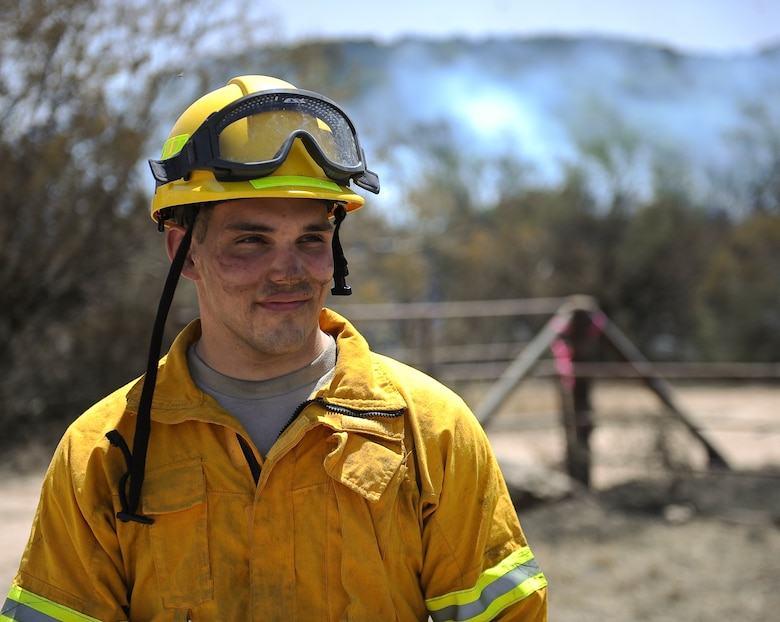 U.S. Air Force Airman 1st Class Richard Thomas, 7th Civil Engineer Squadron firefighter, assisted with the containment of a 1,600 acre wildfire April 28, 2014, near Buffalo Gap, Texas. Seven Dyess firefighters along with numerous other firefighters from the surrounding Big Country region responded to the blaze. (U.S. Air Force photo by Airman 1st Class Kedesha Pennant/Released)