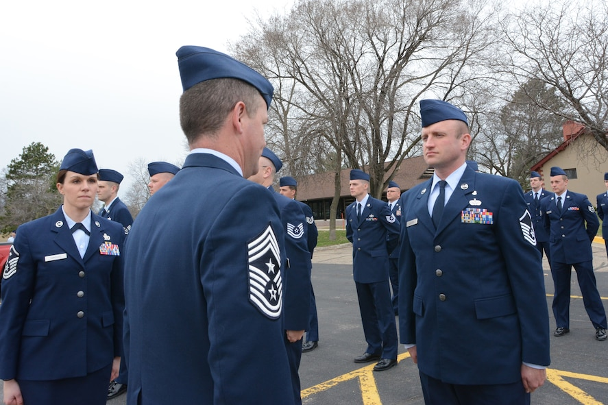 Command Chief Master Sgt. Gregory A. Cullen, Wisconsin's senior enlisted leader, inspects Airmen who attended the second phase of the inaugural State Enlisted Development Program at Volk Field Air National Guard Base, Wis., April 23, 2014. Twenty-one Airmen from across the state of Wisconsin graduated the following day. (Air National Guard photo by Senior Airman Andrea F. Liechti)
