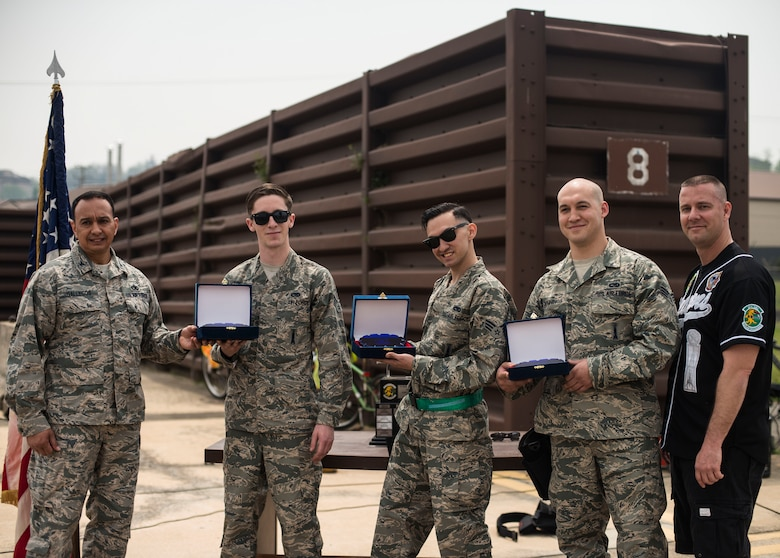 The 25th Aircraft Maintenance Unit weapons load crew team wins the 2014 Korean Peninsula Weapons Loading Competition April 26, at Osan Air Base, Republic of Korea. The 25th AMU completed the loading of their A-10 in 12:35 and outperformed three others teams to win the competition. (U.S. Air Force photo by Staff Sgt. Jake Barreiro)