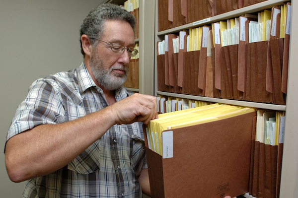 Gary Davis, regulatory official at the U.S. Army Corps of Engineers Nashville District Western Regulatory Field Office in Decatur, Ala., looks at files at the office July 29, 2014.