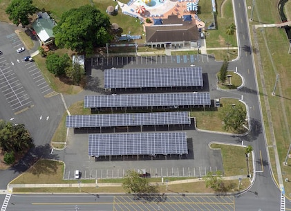 Parking canopies are one of many photovoltaic projects helping reduce energy consumption on Fort Buchanan, Puerto Rico. A total of 21,824 solar photovoltaic panels will produce about 5.5 megawatts of power, which is at least 60 percent of the installation's current power demand at its peak production.