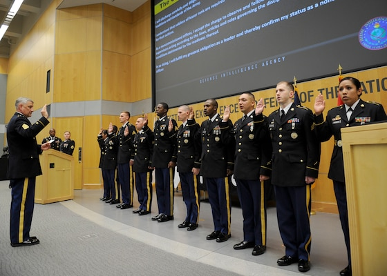 Sgt. Maj. of the Army Raymond F. Chandler III leads the induction of 10 soldiers assigned to DIA to the honorable title of noncommissioned officer July 29.