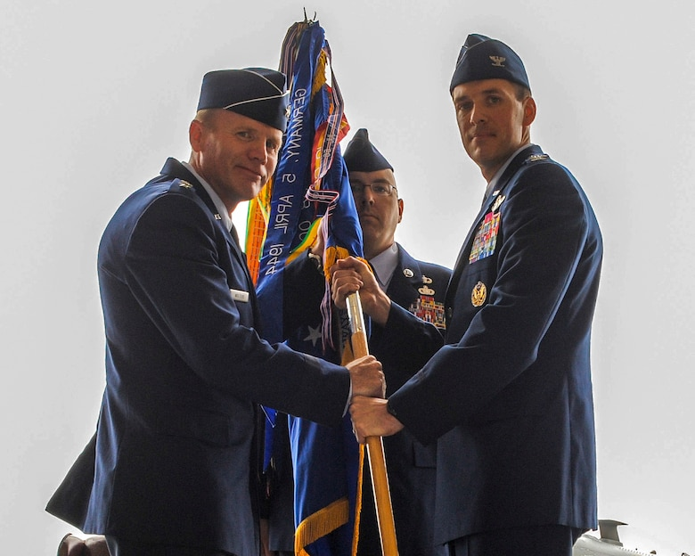 U.S. Air Force Col. James P. Meger receives the 355th Fighter Wing guidon from Lt. Gen. Tod D. Wolters, 12th Air Force (Air Forces Southern) commander, during a change of command ceremony at Davis-Monthan Air Force Base, Ariz., Aug. 1, 2014. Meger replaced Col. Kevin. E. Blanchard and is now responsible for one of the largest installations and flying operations in the United States Air Force, with more than 7,000 Airmen, 3,200 civilians, and more than 100 aircraft.  (U.S. Air Force Photo by Airman 1st Class Chris Drzazgowski/Released)