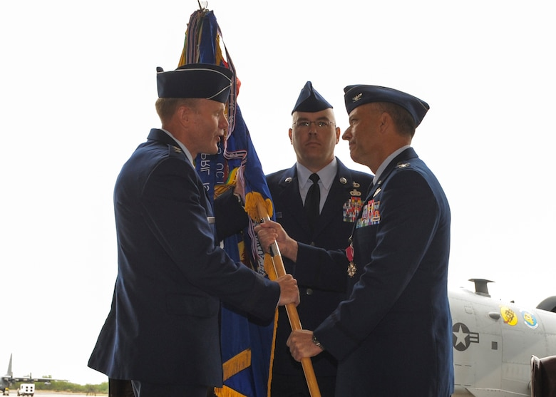 U.S. Air Force Lt. Gen. Tod D. Wolters, 12th Air Force (Air Forces Southern) commander, receives the 355th Fighter Wing guidon from Col. Kevin E. Blanchard during a change of command ceremony at Davis-Monthan Air Force Base, Ariz., Aug. 1, 2014. Blanchard relinquished command of the 355 FW to Col. James P. Meger and will retire from the U.S. Air Force after 23 years of service.  (U.S. Air Force Photo by Airman 1st Class Chris Drzazgowski/Released)