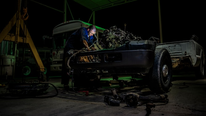 U.S. Air Force Senior Airman Christopher Moore, 386th Expeditionary Logistics Readiness Squadron vehicle mechanic, removes the engine of a truck July 18, 2014 at an undisclosed location in Southwest Asia. Moore has been a mechanic for the Air Force for three years and deployed from the 86th Vehicle Readiness Squadron, Ramstein Air Base, Germany in support of Operation Enduring Freedom. (U.S. Air Force photo by Staff Sgt. Jeremy Bowcock)