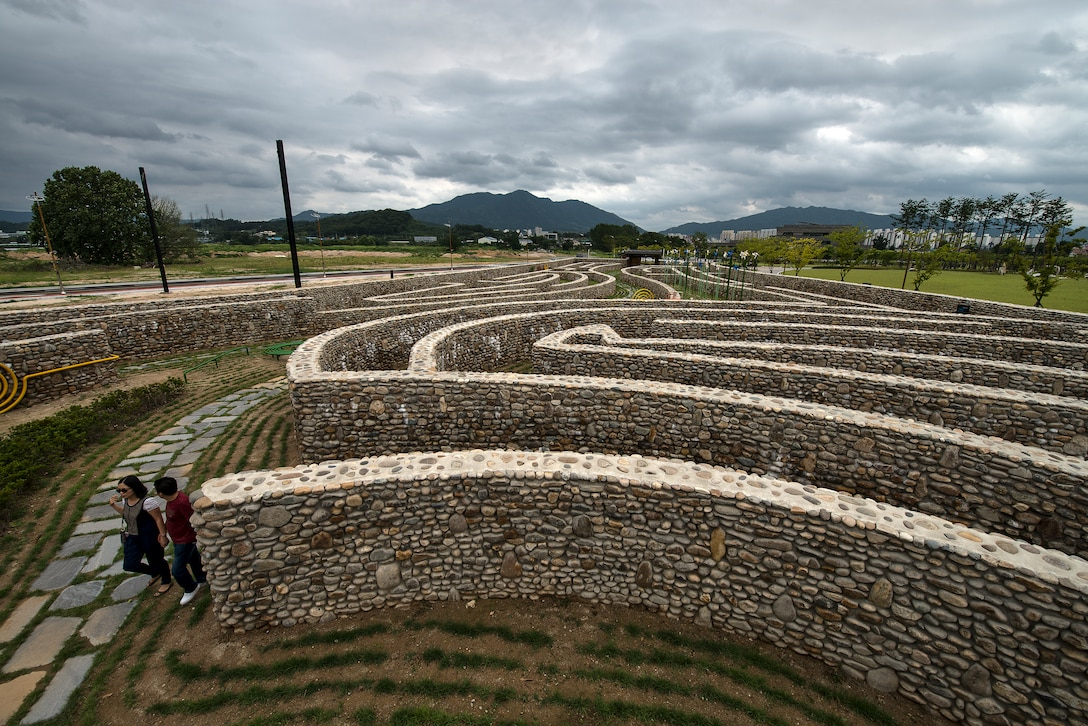 A couple walks through a stone-maze park July 26, 2014, in Chungju, Republic of Korea. Chungju is located in the geographical center of the peninsula of Korea, which made it a vaunted territory in ancient times. (U.S. Air Force photo by Staff Sgt. Jake Barreiro)
