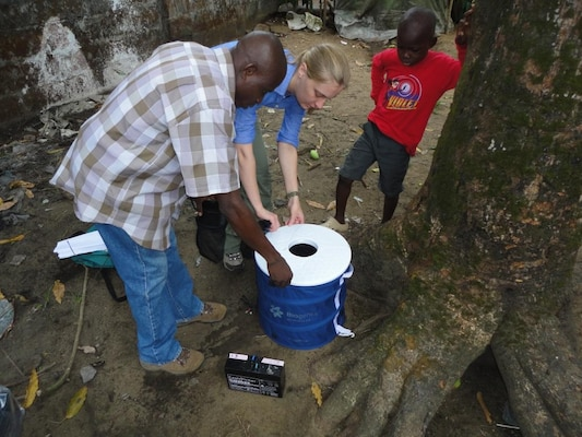 Entomologist Dr. Erica Lindroth from the Walter Reed Army Institute of Research and Lawerence Fakoli from the Liberian Institute of Biomedical Research set a new ruggedized BG-Sentinel mosquito trap for field evaluation in Liberia, Africa. Courtesy photo