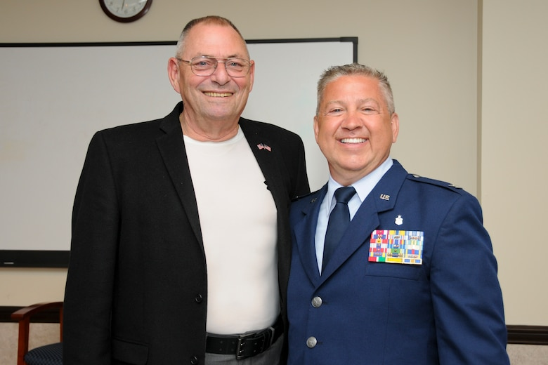 Col. Scott Blum, 108th Medical Group commander, poses for a photograph with retired Col. Barry Johnson after Blum's promotion ceremony at Joint Base McGuire-Dix-Lakehurst, N.J., July 7, 2014. The colonel's insignia on Blum's service coat were passed down to him starting from Col. Johnson's father, who gave them to his son, who in turned passed them on to the former Medical Group commander Col. Sandra Long who passed them on to Blum. (U.S. Air National Guard photo by Senior Airman Kellyann Novak/Released)