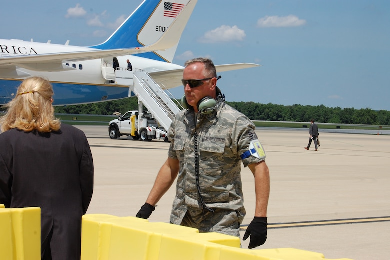 Technical Sgt. Jim Burns, crew chief, 166th Aircraft Maintenance Squadron, placed chocks under the wheels of Air Force One after U.S. President Barack Obama arrives at the New Castle Air National Guard Base, Del. on July 17, 2014. The president came to the home of the 166th Airlift Wing, Delaware Air National Guard en route to the Port of Wilmington, Delaware to announce a new initiative to increase private sector investment in our nation's infrastructure. (U.S. Air National Guard photo by Tech. Sgt. Benjamin Matwey)