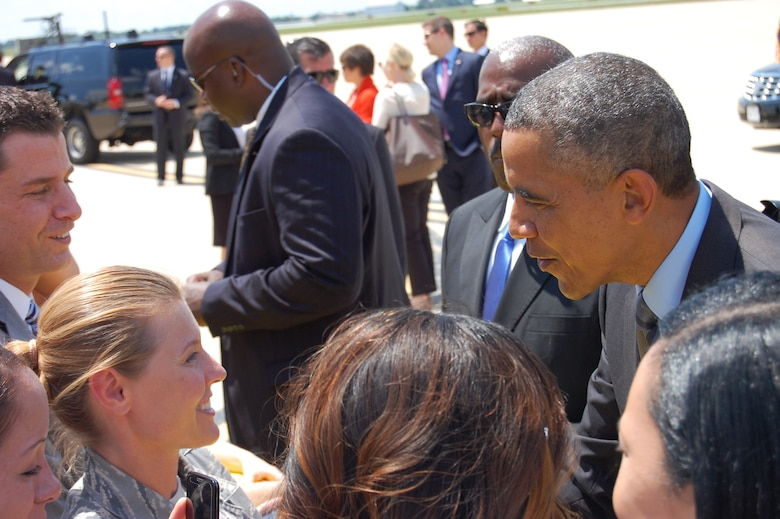 U.S. President Barack Obama greets 2nd Lt. Valerie Harwood, 166th Airlift Wing, as he arrives at the New Castle Air National Guard Base, Del. on July 17, 2014. The president came to the home of the 166th Airlift Wing, Delaware Air National Guard en route to the Port of Wilmington, Delaware to announce a new initiative to increase private sector investment in our nation's infrastructure. (U.S. Air National Guard photo by Tech. Sgt. Benjamin Matwey)
