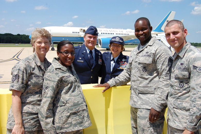 Staff Sgt. Gerilynn Norris, 166th Airlift Wing, Airman 1st Class Katesha Tolson, 166th Communications Flight, 166th Airlift Wing Commander Col. Mike Feeley, Delaware National Guard Assistant Adjutant General for Air Brig. Gen. Carol Timmons, Staff Sgt. Rahim Banks, 166th Security Forces Squadron, and Airman 1st Class Alvin Hall, 166th SFS pose for a photo with Air Force One in the background on July 17, 2014. U.S. President Barack Obama came to the home of the 166th Airlift Wing, Delaware Air National Guard en route to the Port of Wilmington, Delaware to announce a new initiative to increase private sector investment in our nation's infrastructure. (U.S. Air National Guard photo by Tech. Sgt. Benjamin Matwey)