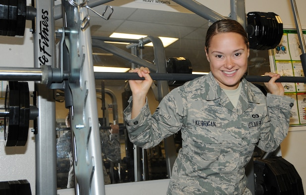 Airman 1st Class Danielle Kerrigan, 161st Operations Group aviation resource management apprentice, poses for a photo in the on-base gym, 161st Air Refueling Wing, Phoenix, Aug. 2, 2014. Kerrigan, who recently returned from Air Force basic training, competed in the 2012 Olympic Trials; placing 6th overall. (U.S. Air Force Photo by Technical Sgt. Courtney Enos/Released)