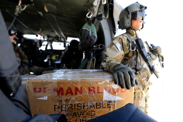 U.S. Army Spc. Robert Moher, 159th Combat Aviation Brigade crew chief, stands by to deliver blood in Afghanistan, July 2014. Moher, a Harlem, N.Y. native, is deployed from Fort Campbell, Ky. Joint Theater Trauma System members ensure fresh blood is always on hand. (U.S. Air Force photo by Senior Airman Sandra Welch)