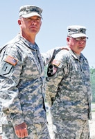 Maj. Gen. Paul E. Funk II, 1st Inf. Div. and Fort Riley commanding general, recognizes Sgt. Jeffrey Cusic, 1st SMC, 541st CSSB, July 8 at Fort Riley for his quick response in intervening with a potential suicide attempt and coming to the aid of a Soldier.