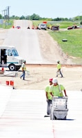 Engineers with the U.S. Corps of Engineers, Kansas City District, Fort Riley office, work on the roundabout in construction July 9 on Estes Road at Fort Riley.