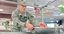 Spc. Daniel Matthey, 601st ASB, 1st CAB, puts out salad ingredients for lunch July 7 at the Demon Diner dining facility. The Demon DFAC won Phase II of the Philip A. Connelly evaluation and will go on to represent IMCOM West at the FORSCOM level of competition.