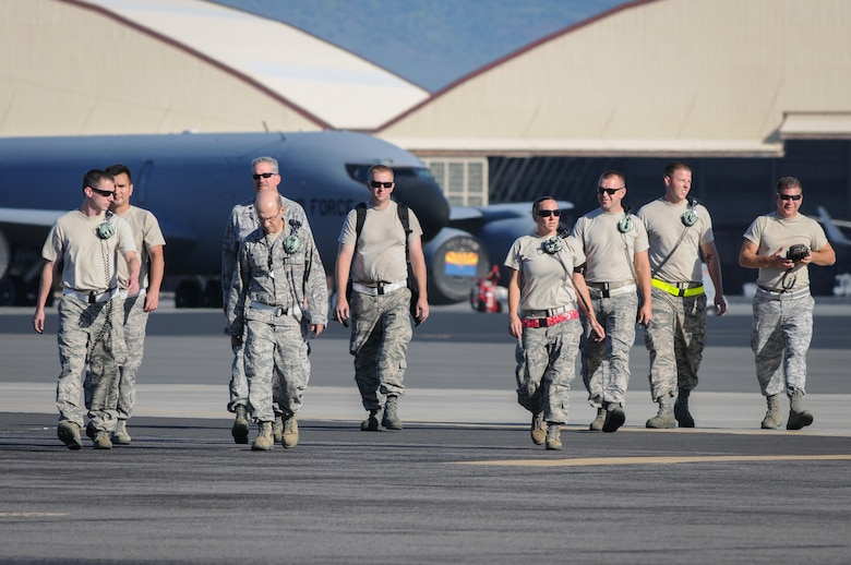 Maintenance reservists from the 513th Air Control Group at Tinker Air Force Base, Oklahoma, walk off the flight line after launching an E-3 Sentry Airborne Warning and Control System aircraft July 24 at Joint Base Pearl Harbor-Hickam, Hawaii. More than 60 reservists from the 513th Air Control Group traveled from Tinker to participate in the Rim of the Pacific, or RIMPAC, 2014 exercise, the world's largest maritime exercise held biannually in and around the Hawaiian islands. (U.S. Air Force photo by Staff Sgt. Caleb Wanzer)