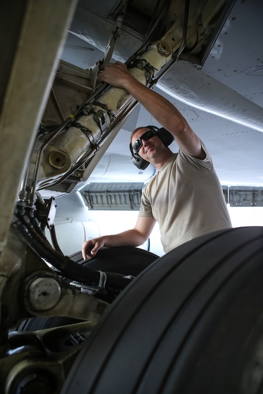 Tech. Sgt. Douglas Wall, assigned to the 513th Maintenance Squadron at Tinker Air Force Base, Oklahoma, checks hydraulic lines on the landing gear of an E-3 Sentry Airborne Warning and Control System aircraft July 14 on the flight line at Joint Base Pearl Harbor-Hickam, Hawaii. Wall is part of more than 60 reservists with the 513th Air Control Group who traveled from Tinker to participate in the Rim of the Pacific, or RIMPAC, 2014 exercise, the world's largest maritime exercise held biannually in and around the Hawaiian islands. (U.S. Air Force photo by Staff Sgt. Caleb Wanzer)