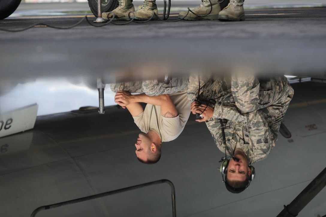 Maintenance Airmen from the 513th Air Control Group rest before working to launch an E-3 Sentry Airborne Warning and Control System aircraft July 20 for a mission in support of RIMPAC 2014 at Joint Base Pearl Harbor-Hickam. The Rim of the Pacific exercise is the world's largest maritime exercise that also includes more than 200 joint and allied aircraft. (U.S. Air Force photo by Staff Sgt. Caleb Wanzer)