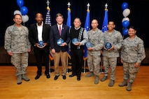PETERSON AIR FORCE BASE, Colo. — The 21st Space Wing held its quarterly awards breakfast for the second quarter July 29 at The Club. Col. John Shaw (left), 21st SW commander, and Chief Master Sgt. Idalia Peele (right), 21st SW command chief, presented the awards, including: Airman of the quarter -- Airman 1st Class Christian Mejia, 721st Security Forces Squadron; NCO of the quarter -- Staff Sgt. Angelo Tafoya, 21st Medical Group; Senior NCO -- Master Sgt. Karen Cullen, 821st Air Base Group; Company grade officer -- 2nd Lt. Benjamin Brinich, 21st Operations Group; Civilian category I -- Daniel Bermudez, 21st Mission Support Group; Civilian category II -- Claudia Thew, 21st Wing Staff Agencies; Civilian category III -- Michael Cramer, 21st WSA; and Civilian supervisory category -- Courtney Davis, 21st OG. The local winners go on to represent the wing at the Team Pete quarterly awards competition. (U.S. Air Force photo/Dennis Howk)