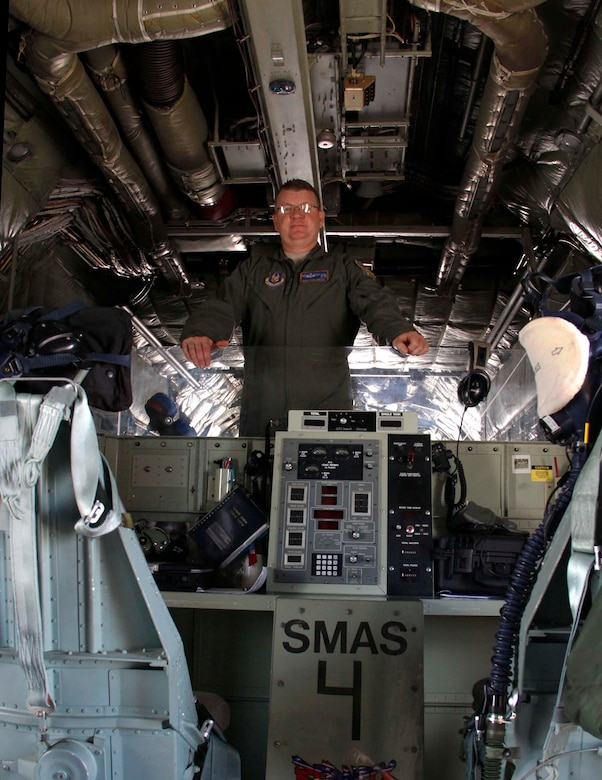 Master Sgt. Rich Lawton, engineer from the 910th Airlift Wing in Youngstown, Ohio, stands in the cargo bay of the C-130 plane at Homestead Air Reserve Base, Fla., July 31.  Lawton is a member of the crew that performed the aerial spray mission to reduce the mosquito population in Homestead and the surrounding Miami-Dade County. (U.S. Air Force photo by/Senior Airman Jaimi L. Upthegrove)