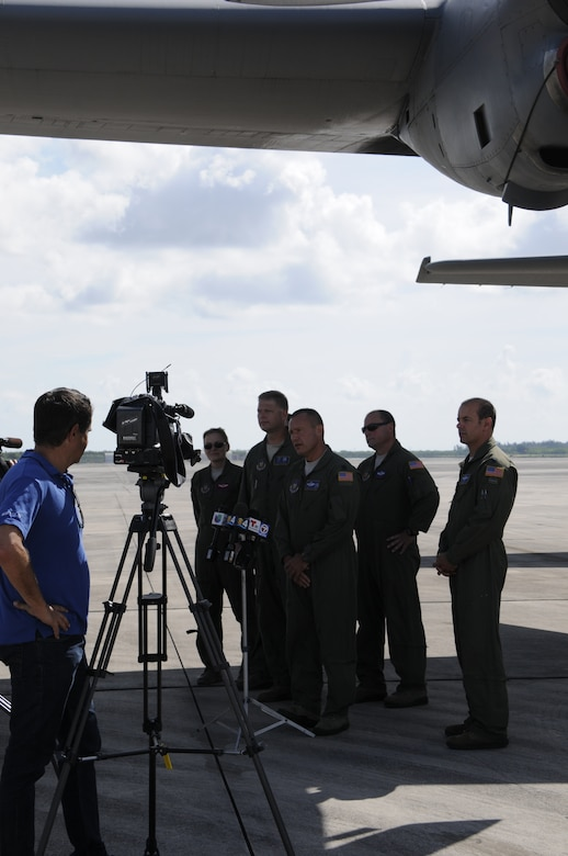 Skilled air crew from the 910th Airlift Wing in Youngstown, Ohio speak with local press about aerial spray mission at Homestead Air Reserve Base, Fla., July 31. The flight crew is environmentally conscious and works with local authorities to prevent harming critical habitat areas and national parks. (U.S. Air Force photo by/Senior Airman Aja Heiden)