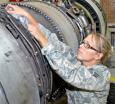 U.S. Air Force Senior Airman Crystal Steiger, an aerospace propulsion mechanic with the 116th Maintenance Group, Georgia Air National Guard, ensures tube openings are covered on a TF-33 Pratt and Whitney jet engine that is used on the E-8C Joint STARS at Robins Air Force Base, Ga., July 17, 2014.  Steiger was the 2013 Airman of the Year award winner for the 116th Air Control Wing. (U.S. Air National Guard photo by Tech. Sgt. Regina Young/Released)