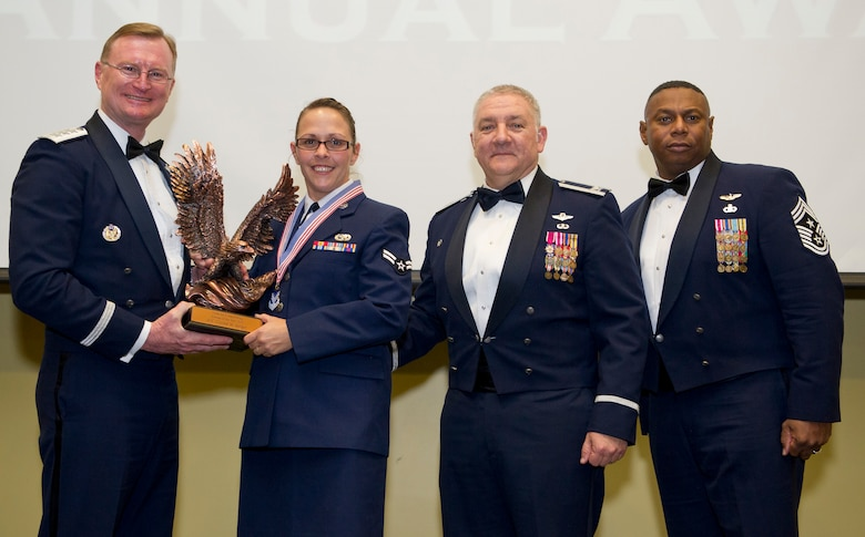 U. S. Air Force Airman 1st Class Crystal Steiger, an aerospace propulsion mechanic with the 116th Maintenance Group, Georgia Air National Guard, is awarded Airman of the Year at the Annual Awards Banquet at the Anderson Conference Center, Macon, Ga., Jan. 10, 2014.   Steiger was the 2013 Airman of the Year award winner for the 116th Air Control Wing.  (U.S. Air National Guard photo by Master Sgt. Roger Parsons/released)