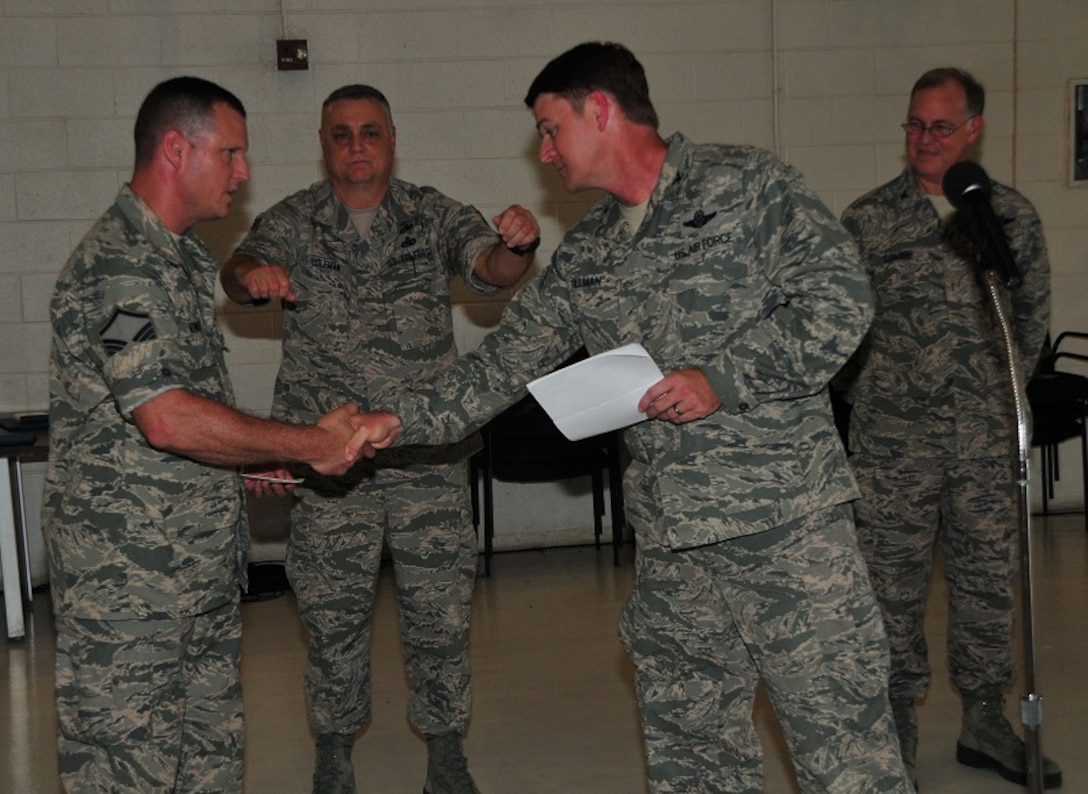 172d Airlift Wing Maintenance Group member, Master Sgt. Brian Kennedy (left) has has been named the Air National Guard's 2013 CMSAF Thomas N. Barnes Crew Chief of the Year Award winner.  Kennedy is shown being congratulated by 172d Vice Wing Commander, Col Tommy Tillman.  The announcement marks the first time that a Mississippi National Guardsmen has won the award.