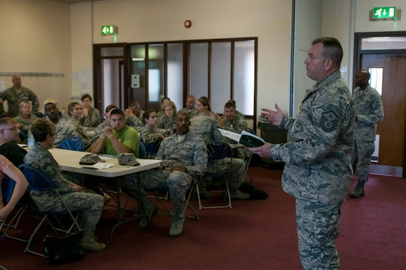 Master Sgt. Jeffrey Jones gives a First Sgt. briefing to members of the Ohio Air National Guard at RAF Lakenheath on July 29, 2014. The Ohio Air National Guard has members from the 121st Air Refueling Wing, 179th Airlift Wing, and 180th Fighter Wing training with active duty counterparts from their specific career fields working with both RAF Mildenhall and RAF Lakenheath. (U.S. Air National Guard photo by Tech. Sgt. Zachary Wintgens/Released)