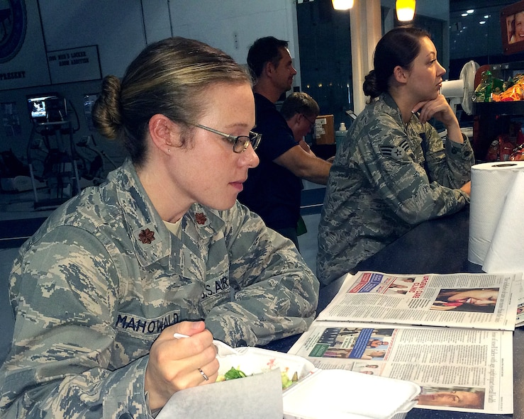U.S. Air Force Maj. Heather Mahowald, U.S. Strategic Command individual mobilization augmentee, reads the newspaper while enjoying her lunch at Smoothalicious June 6 inside of the Offutt Field House. Since its opening, Smoothalicious has seen a business increase of 204 percent over the previous owner.  (U.S. Air Force photo by D.P. Heard/Released)