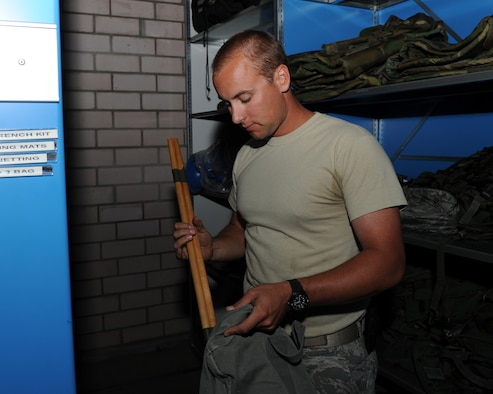 U.S. Air Force Senior Airman Ryan Maxwell, a 606th Air Control Squadron materiel management specialist from Yorktown, Va., creates an initial issue bag July 30, 2014, at his squadron at Spangdahlem Air Base, Germany. Airmen use the bags during exercises and other training functions to maintain proficiency and readiness for when they are called upon by combatant commanders to deploy. (U.S. Air Force photo by Airman 1st Class Dylan Nuckolls/Released)
